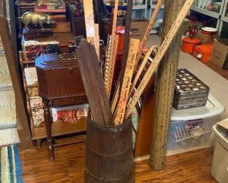 Antique Barrel with Yard Sticks