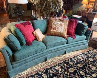 sofa and rug with many throw pillows