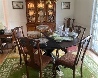 Harden Breakfront, Beveled Glass Dining Table with custom pad. 6 Chippendale Style Chairs to include 2 Captains Chairs