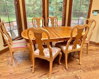 """$395 - Knotty pine dining table with two leaves and pads (not shown).  Table 29.5""""H x 65.5""""W (with each 18""""W leaves inserted 101.5""""W) x 43""""D."""