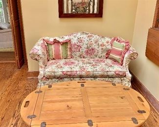 """$325 - Floral slipcovered camel back love seat. 27.5""""H x 60""""W x 32""""D (seat height 20""""H)"""