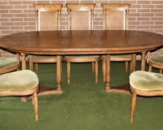"Thomasville Furniture Company Mid-Century (1965) Dinning Room Table with Federal Style Cane Chairs (6) Side Chairs (2) Captain Chairs Oval table (66""x 45"") w/ (2) leaves 18"" ea."
