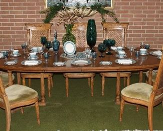 "Thomasville Furniture Company Mid-Century (1965) Dinning Room Table with Federal Style Cane Chairs (6) Side Chairs (2) Captain Chairs Oval table (66""x 45"") w/ (2) leaves 18"" ea. Shown with both leaves. (66"" x 71"")"