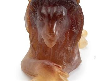 """6 A Daum Pâte De Verre Lion Fourth-quarter 20th Century Signed and editioned to tail: Daum / 358/1000 The recumbent lion in dark to light amber glass with paws crossed 8"""" H x 18"""" W x 5.5"""" D Estimate: $2,000 - $3,000"""