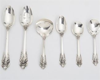 """10 A Wallace """"Grand Baroque"""" Sterling Silver Flatware Service Second-half 20th Century Each marked for Wallace / Sterling; Knives further marked: Wallace / Sterling Handle / Stainless Blade Designed 1941 by William S. Warren comprising 12 hollow-handled steak knives (9.5""""), 12 hollow-handled dinner knives (9""""), 1 master butter knife (6.625""""), 12 dinner forks (7.5""""), 12 salad forks (6.5""""), 12 spoons (6.875""""), 12 teaspoons (6.125""""), 12 round-bowl soup spoons (6.125""""), 2 serving forks (8.125""""), 3 serving spoons (8.75""""), 1 pierced serving spoon (8.75""""), 1 gravy ladle (6.625""""), and 1 sugar spoon (6.25""""), 93 pieces Weighable sterling: 122.155 oz. troy approximately Estimate: $2,500 - $3,500"""