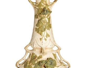 """9 A Royal Dux Art Nouveau Vase Circa 1900-1918 Marked for Royal Dux Bohemia: [Rose-Triangle Acorn] The large vase with a double-handled rim and additional handles to base adorned with pressed and painted ginkgo leaf design and gilt decoration 19.5"""" H x 12"""" W x 10"""" D Estimate: $500 - $700"""