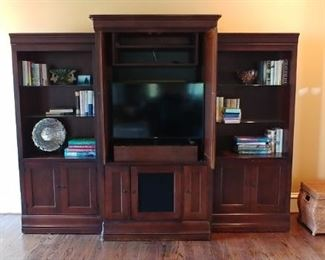 Only the center section of the entertainment center is for sale. All the small items are for sale.