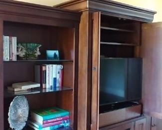 The center piece of the entertainment center is for sale