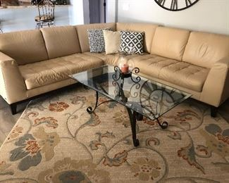 BEAUTIFUL LEATHER SECTIONAL,  AREA RUG,  COFFEE TABLE