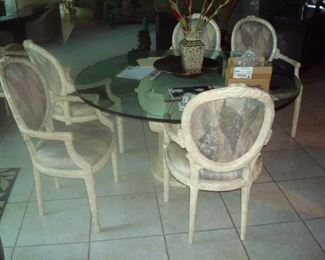Glass top pedestal table with set of chairs.