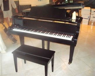 Young Chang G-183 polished ebony grand piano and bench.