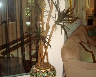 Large indoor plant in inlaid tile planter.