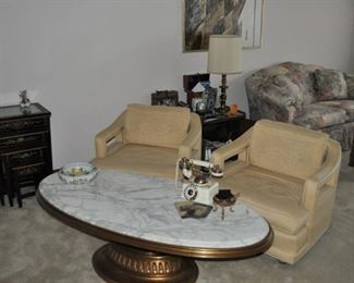 """Set of four Chinoiserie nesting lacquered tables with glass insert on tops largest 20"""" x 15"""" and 26"""" high, 1960s Hollywood Regency Weiman Heirloom Quality gold leaf oval coffee table with footed wooden base and white granite top 56"""" x 27"""" and 17"""" high, Luxor 1962 mid-century open-arm original upholstery pair of armchairs on casters with down/feather back cushions, Schnadig floral upholstered camel back rolled arm loveseat with removable seat cushions and pillows 66"""" long, Schnadig floral upholstered camel back rolled arm sofa with removable seat cushions and pillows 90"""" long"""
