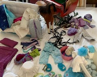 American Girl Dolls from the early 2000s with boxes. Samantha and Kit Central Park Sleigh with horse - very rare. Boogie board and snorkeling set, snowboard set, sleeping bag, bubble bath, trundle bed with sheets and quilt, all retired items.