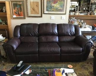 Couch with reclining seats on both ends.