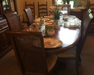 Dining  table with 6 chairs and leaf expansion.