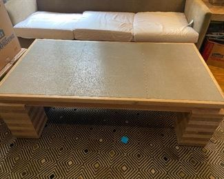 """Beautiful coffee table with crackle leather top. Table measures 32"""" x 60"""" x 19 1/2"""" h.  $590.  Carpet is not for sale"""