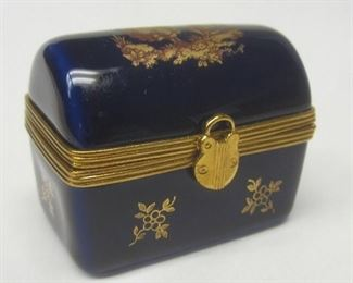 """A porcelain trinket box in the form of a dome top trunk.  marked Limoge France on the base 1.75"""" wide"""