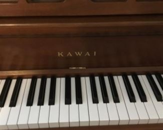 Kawai made in Japan I perfect working condition. Solid cherry wood.         $2000. Or best offer