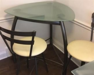 Glass top table and two chairs $75.00