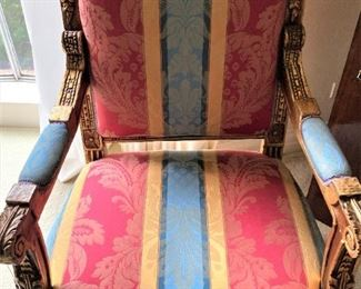 One of two matching antique chairs.
