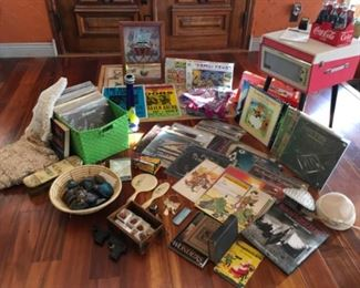 Crosley record player, vintage LP collection, Hand crocheted linens, shams, Zuni clock, vintage hats, books, Vintage toy guns,  antique glove box, music posters, geodes.