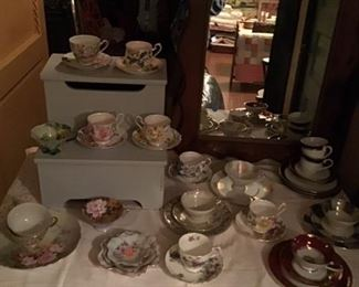 Antique cups and saucers, vintage mirror