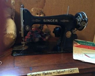 Vintage Singer Sewing Machine with original cabinet