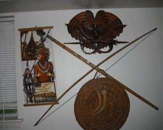Bucca basket, gourd cod pieces, bow and arrows