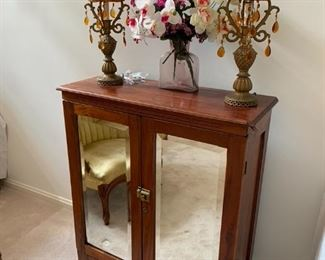 Antique music cabinet with mirror front.