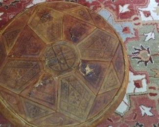 Antique tooled leather ottoman