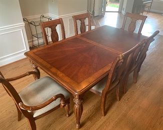 Dining table has two additional leaves
