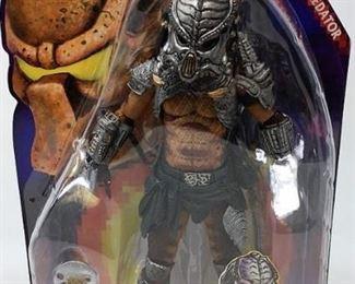 https://connect.invaluable.com/randr/auction-lot/neca-predator-series-13-cracked-tusk-predator_8344D83BD8