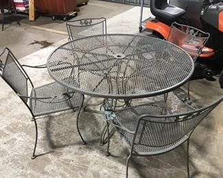 Round wrought iron table with 4 chairs