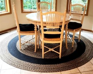 Kitchen table & chairs has leaves & round braided rug