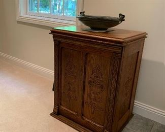 Heavily carved antique cabinet