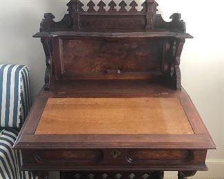 Eastlake slant top desk with leather inlay