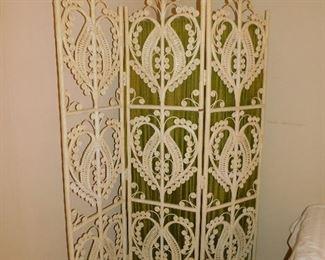White wicker room divider.