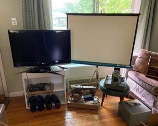 Flat screen TV's, Projector and projector screen, Vintage sewing machine