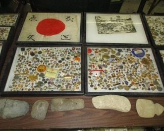 Cases of small pins and badges