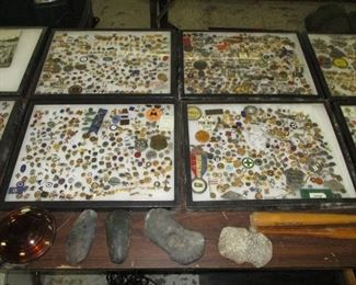 Cases of pins and small badges