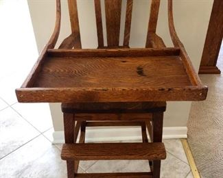 Antique tigard oak high chair.