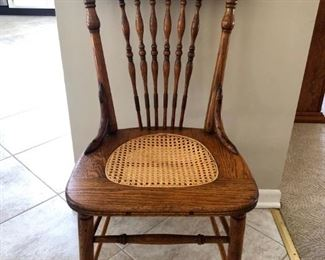 Antique caned seat oak chair. Great accent chair. Nice turned features.