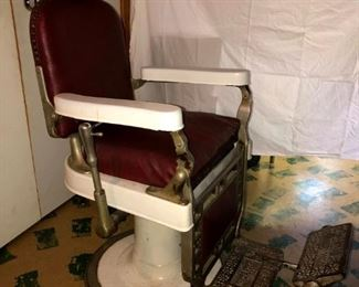 Authentic 1920's Theo A Kochs Barber Chair in very good condition. Original red leather. Lift works fine.