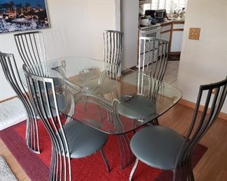 Metal and glass dining table and six chairs