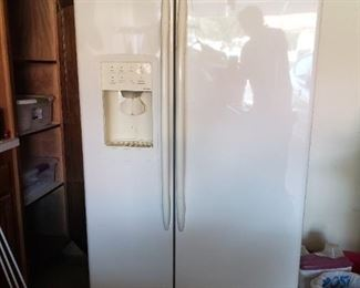 GE profile Arctica side by side refrigerator