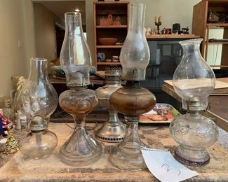 3. set of 5 lamps and 4 hurricane tops $50
