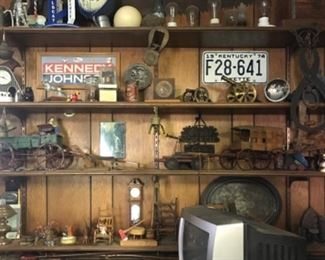 Vintage campaign signs, license plates, cast iron, primitive toys,  Ice tongs, buckles.