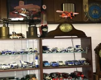 Metal airplanes, vintage blow torches, collectible University of Kentucky models and other models. Vintage signs