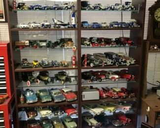 Huge car collection with modern cars as well as replicas of antique cars.